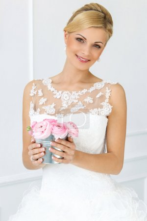 Bride holding pot with roses