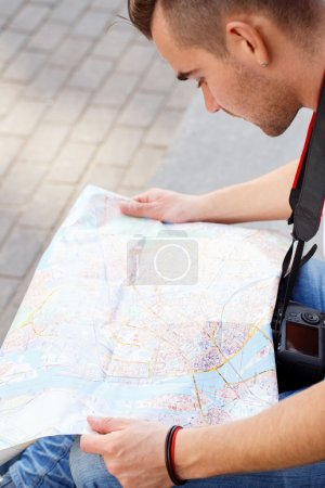 Tourist with map during vacation trip