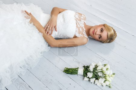 Attractive bride with beautiful bouquet
