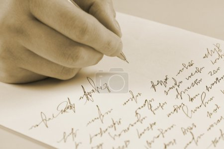 Male hand writing on a paper