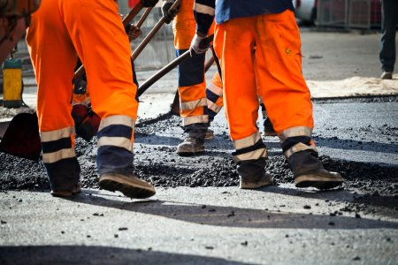 Road construction, teamwork