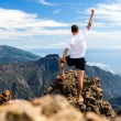 Trail runner, man and success in mountains. Runnin...
