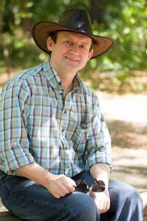 A man in a cowboy hat