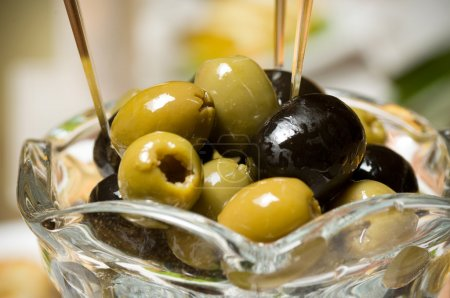 Photo for Black and green olives in a glass cup - Royalty Free Image