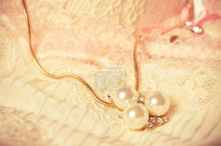 Pearl jewelry on the white background