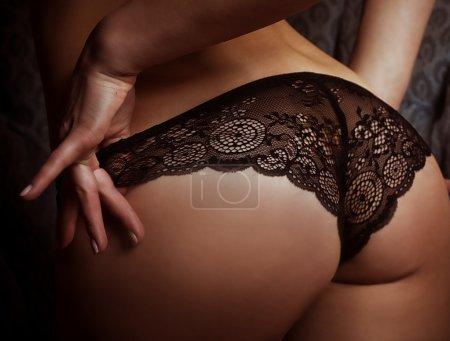 Woman's sexy buttocks in a bikini