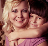 Happy family, young beautiful mother and her little daughter