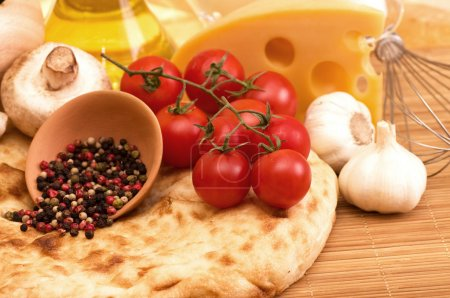 Cherry tomatoes, champignons, spices and garlic. Organic healthy food