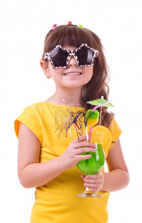 Beautiful little girl drinking green child's cocktail on white background