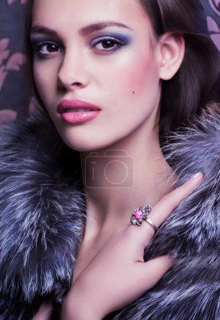 Portrait of a woman in fur coat