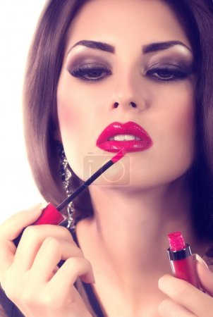 Woman with red gloss lips