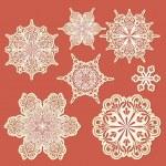Vector paper cut golden snowflakes...