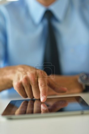 business man use tablet compuer at office