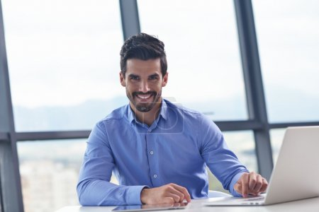 Happy young business man at office