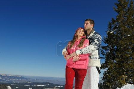 Couple in winter snow scene