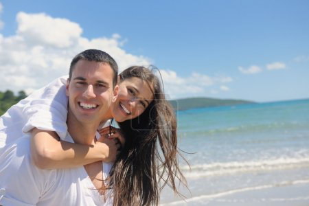 Couple have fun at the beach