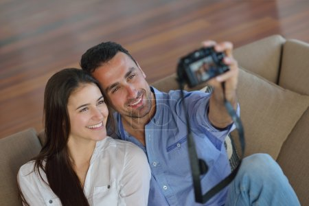 Couple playing with digital camera
