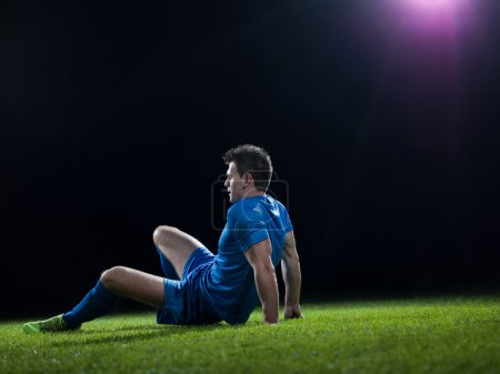 Soccer player doing kick with ball