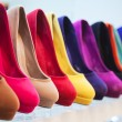 Variety of the colorful leather shoes in the shop...