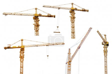 five hoisting cranes isolate on white