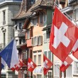 Old street in Zurich decorated with flags for the ...