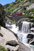 Alpine express passing bridge at St. Gotthard Pass in Switzerlan