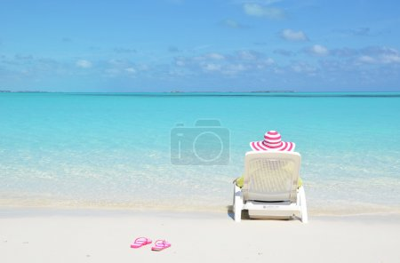 Photo for Girl relaxing on the beach of Exuma, Bahamas - Royalty Free Image