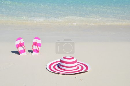 Photo for Flip-flops and hat on the beach - Royalty Free Image