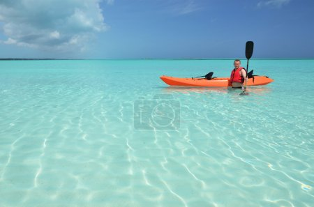 A man with kayak. Exuma, Bahamas