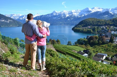 Travelers looking to the map. Switzerland