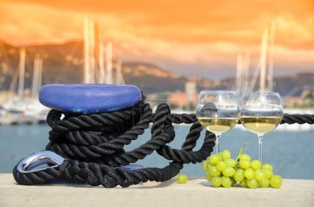 Wineglasses and grapes on the yacht pier of La Spe...