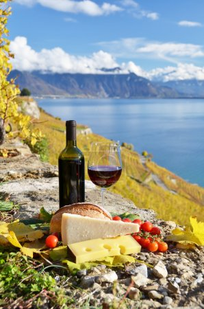 Red wine, cheese, bread and cherry tomatoes
