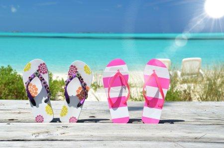 Two pairs of flip-flops against Atlantic