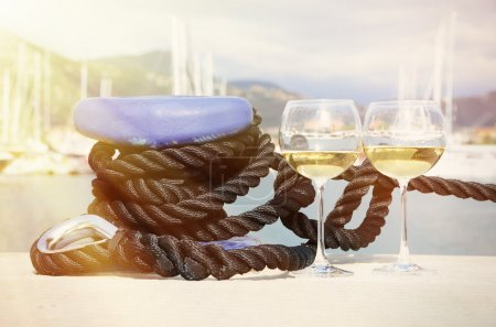 Wineglasses against yachts
