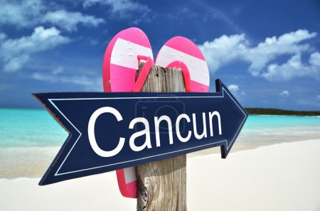 CANCUN sign on the beach