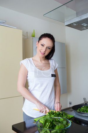 Beautiful woman preparing fresh meal