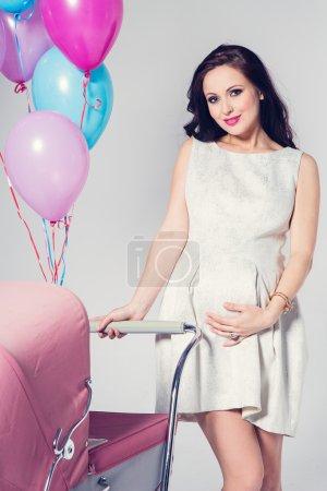 Photo pour Femme sexy avec poussette bébé - image libre de droit