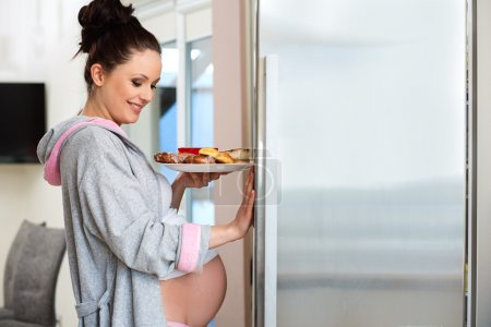 Photo for Beautiful pregnant woman loking for food - Royalty Free Image