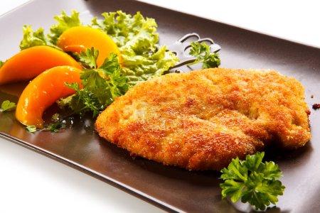 Fried pork chop and vegetable salad
