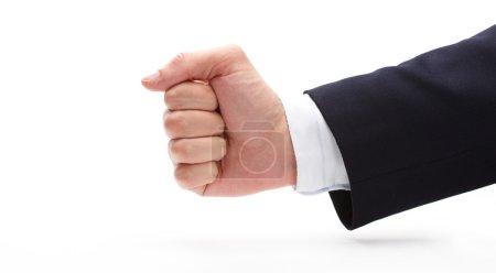 businessman showing fist