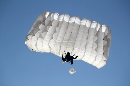 parachutist on blue sky extreme sport