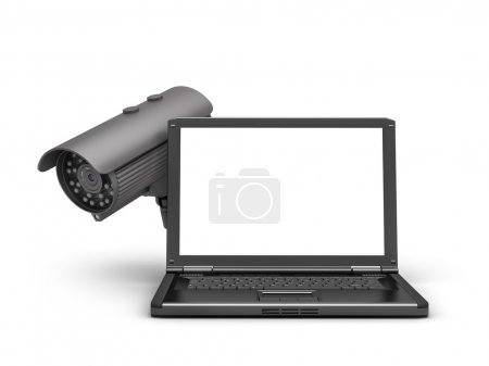 Video surveillance camera and laptop on white background