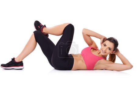 Beautiful young woman doing exercises