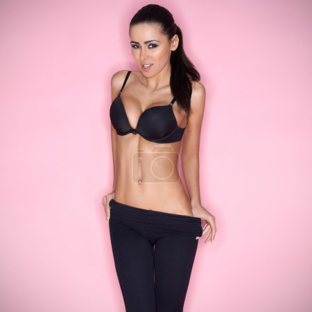 Sexy brunette female model posing in bra