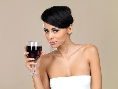 Beautiful woman drinking red wine