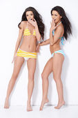 Two girls in swimsuits
