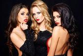 Three beautiful enticing glamorous woman
