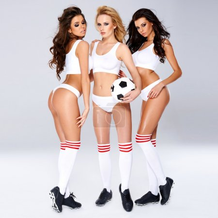 Seductive sexy female soccer players