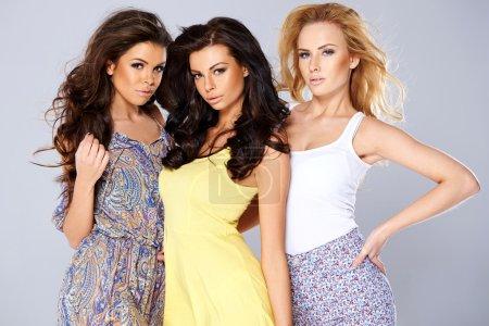 Beautiful seductive trio of young women
