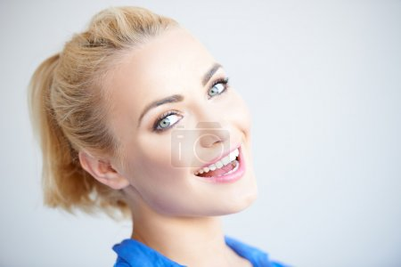 Pretty blond girl laughing at the camera